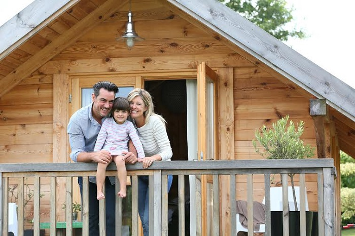 Family enjoying vacation in log cabin